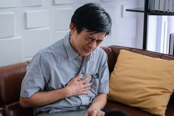 Man having chest pains at home